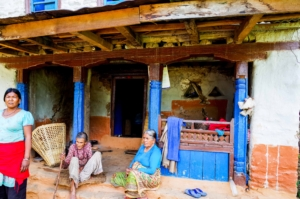 They use the house during the daytime for cooking but at night they have to sleep outside because they are afraid that it can fall anytime.